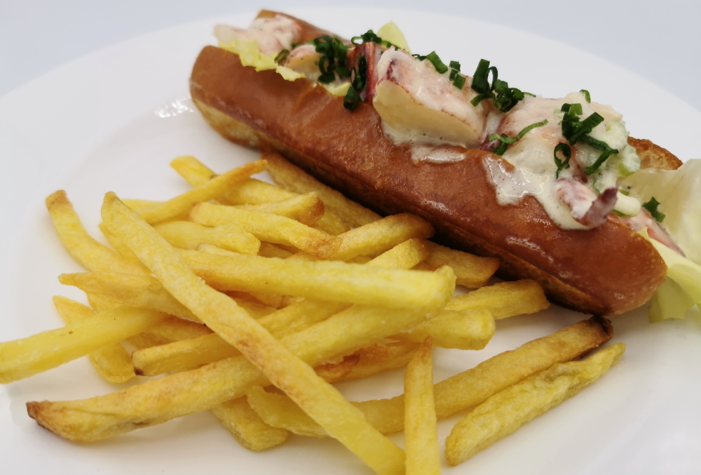 Lobster-roll-with-fries-on-a-plate